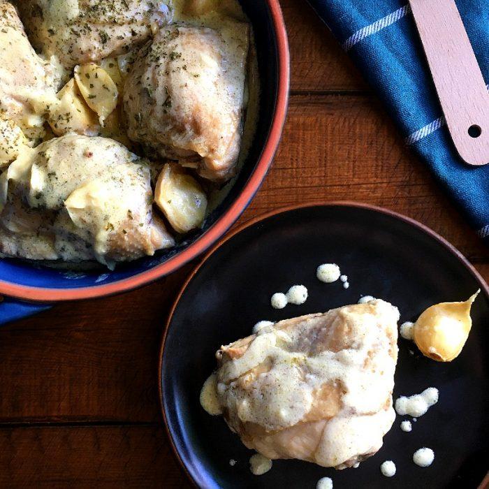 40 cloves garlic chicken served on a plate