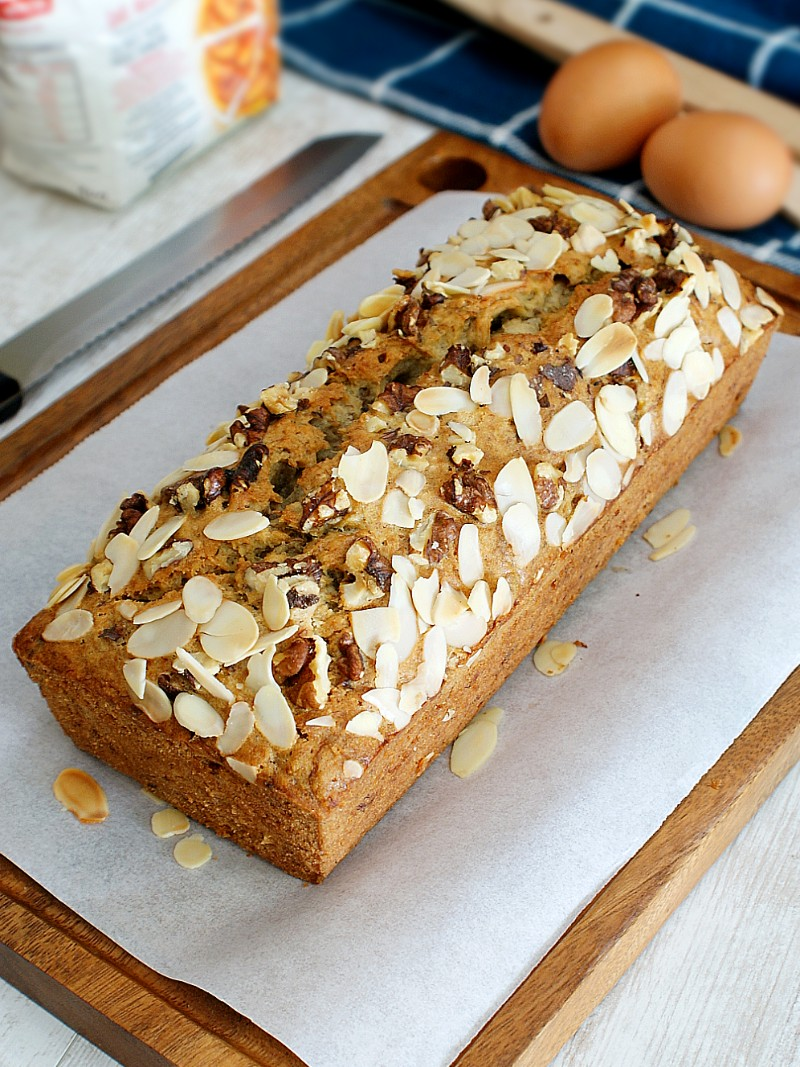 banana bread with walnuts and almonds on top