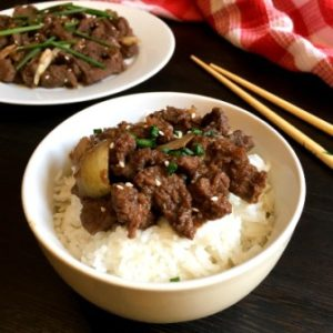 beef bulgogi in a bowl with chopsticks