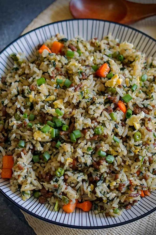 cooked rice with beef and vegetables in a plate