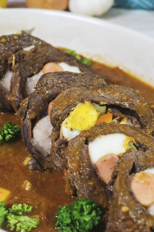 beef roll with stuffing in a plate