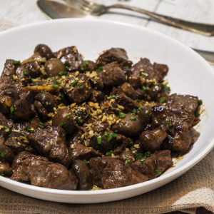 beef with mushrooms in a bowl