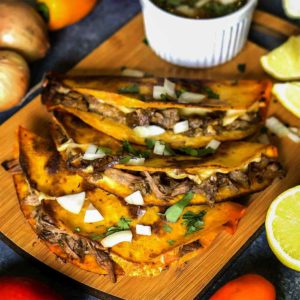 beef inside tortillas with diiping sauce