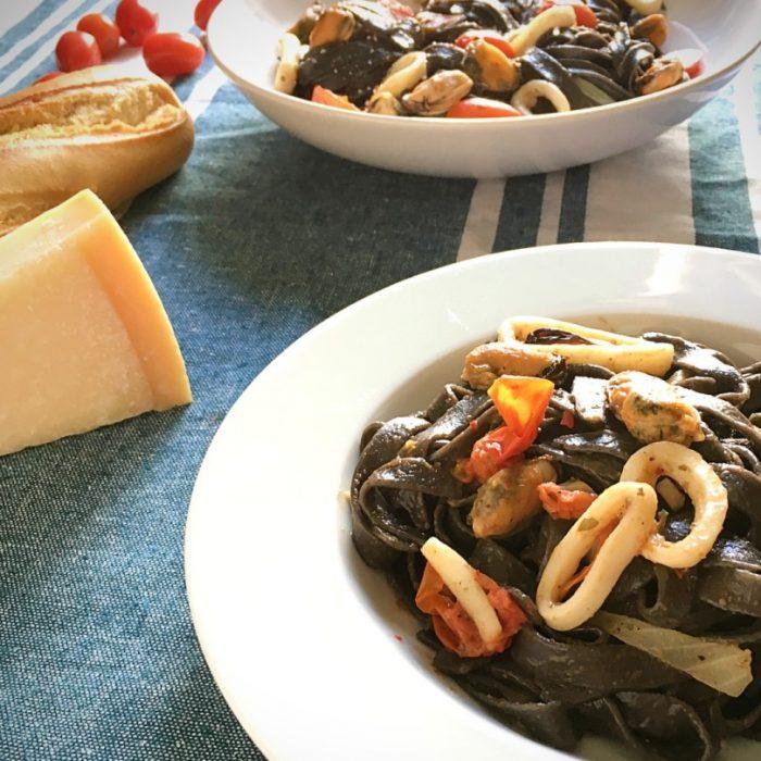 black pasta seafood dish