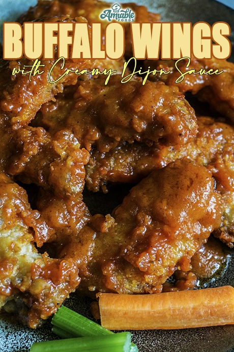 chicken wings with celery and carrot sticks