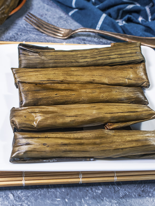 cassava wrapped in banana leaves