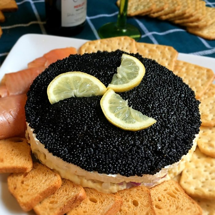 caviar pie with crackers on the side