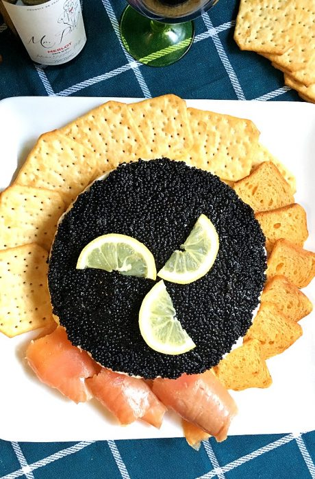 caviar pie garnished with lemon slices