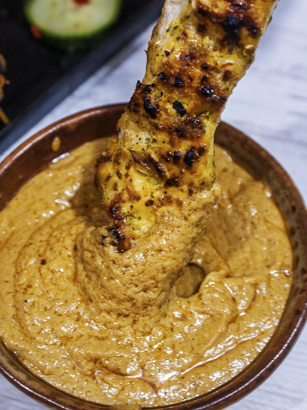 chicken skewer dipped in peanut sauce