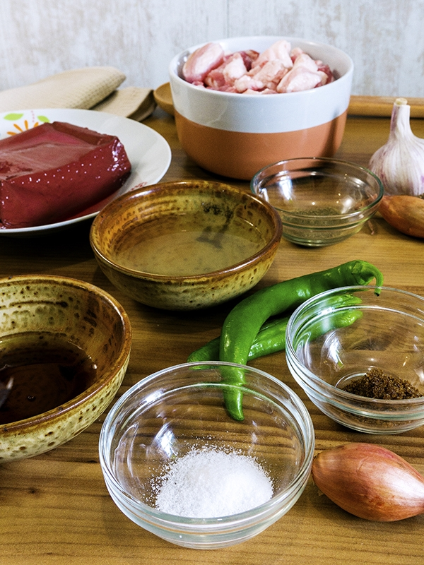 pork blood stew ingredients on top of table