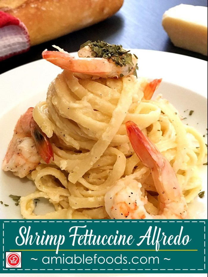 fettuccine alfredo topped with shrimp
