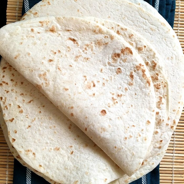 flour tortillas on a kitchen towel