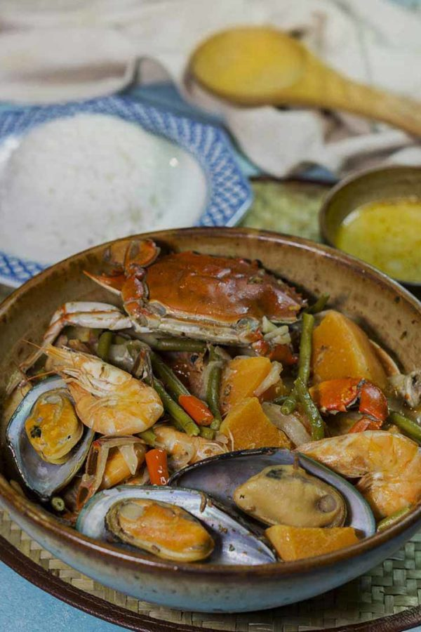 shellfish with vegetables in coconut milk in a bowl