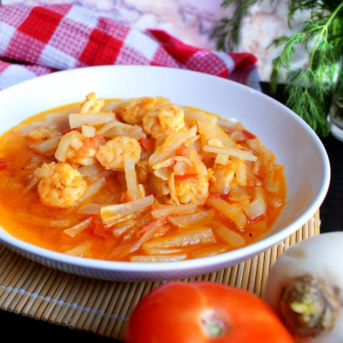guisadong labanos with shrimps on top of table