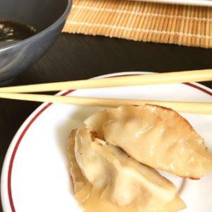 gyoza with chopsticks