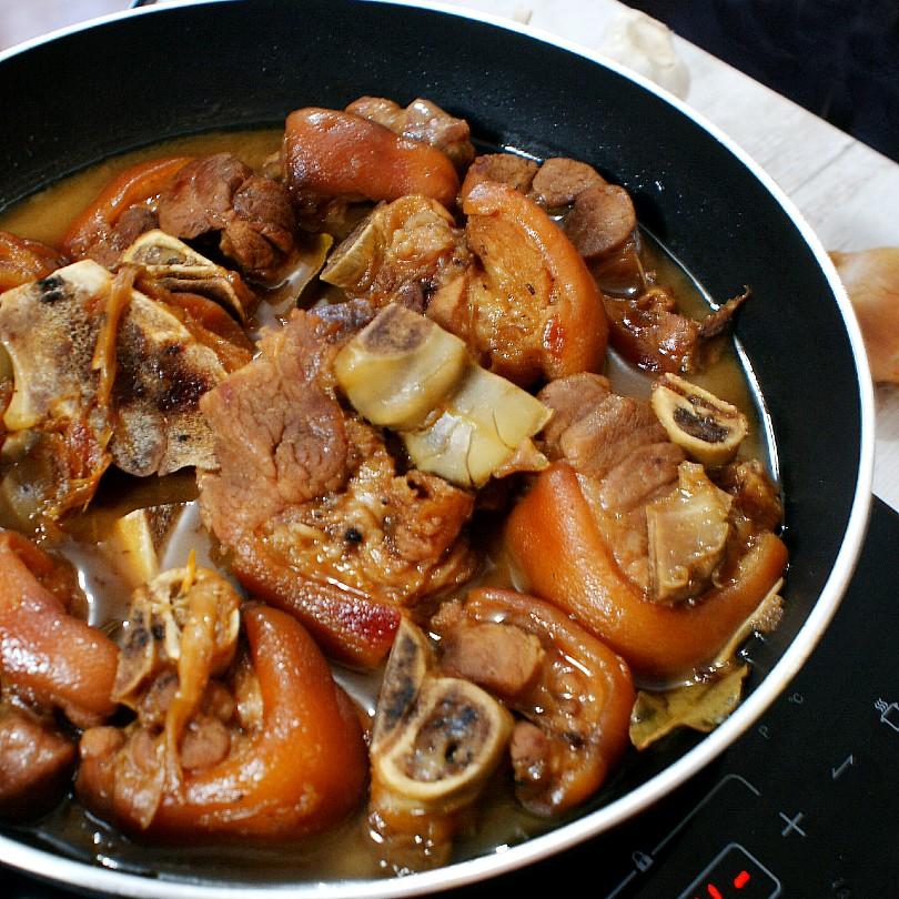 pork pata humba cooking in a pan