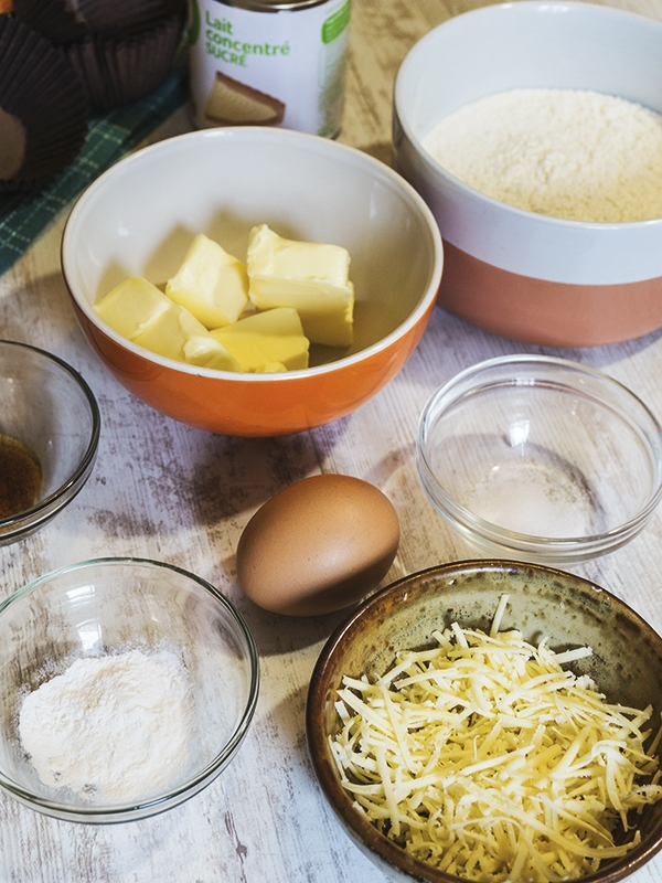 ingredients for cheese cupcakes on top of table