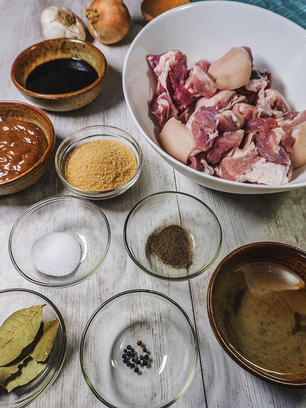 ingredients of pork stew on top of table