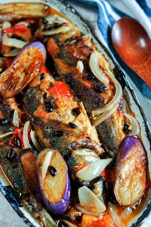fish with eggplant and tomatoes in a plate