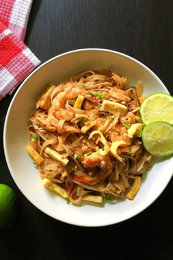 pad thai in a plate on a table