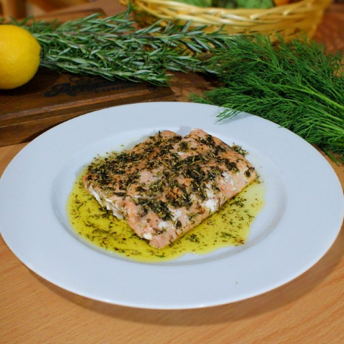 seared salmon and herbs on top of table