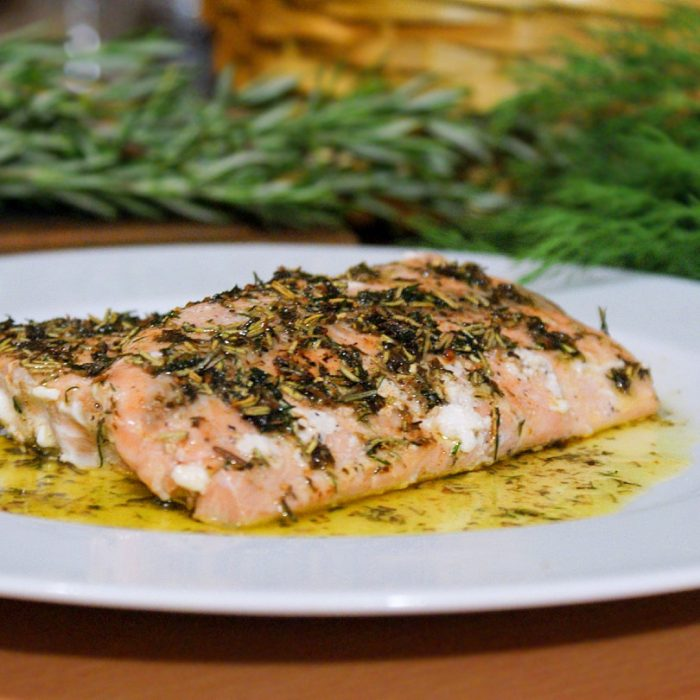 pan-seared salmon with herbs in a plate