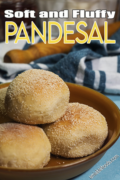 bread rolls in a plate with rolling pin beside