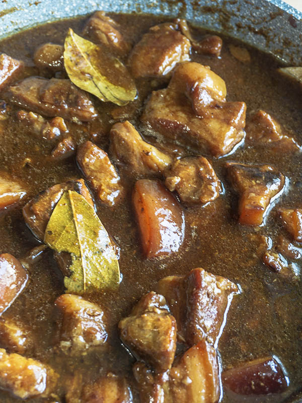 pork stew cooking in a pan