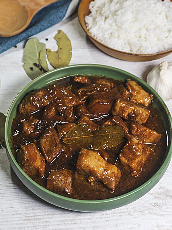 pork stew in a bowl with bay leaves