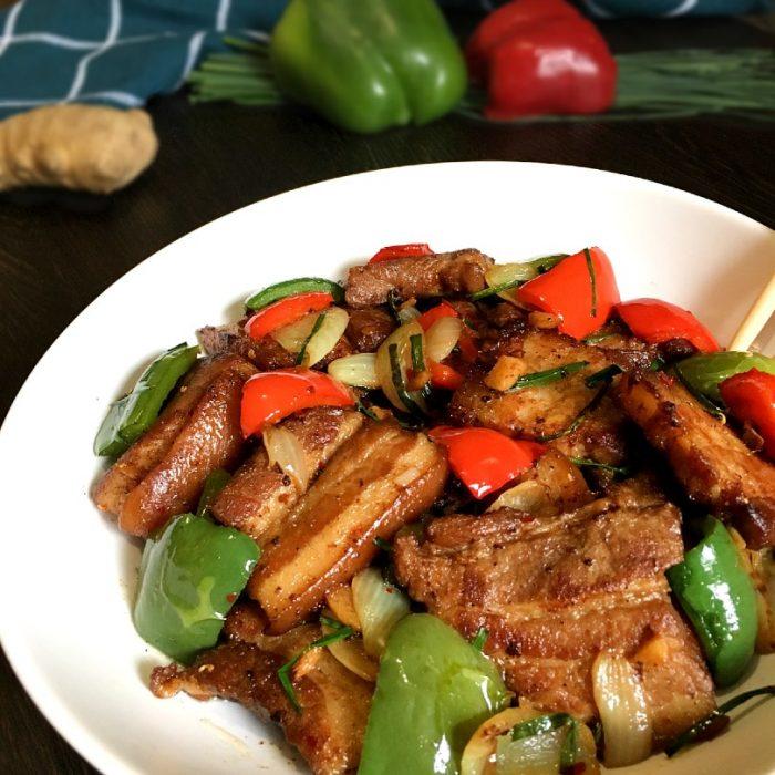 pork stir fry and ingredients as background