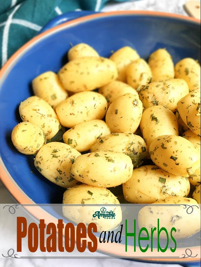 boiled potatoes and herbs in a bowl on a table
