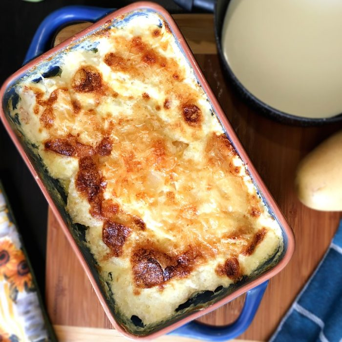 potatoes au gratin in baking dish