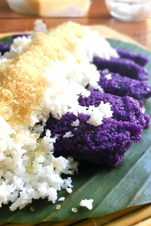 puto bumbong with coconut and sugar