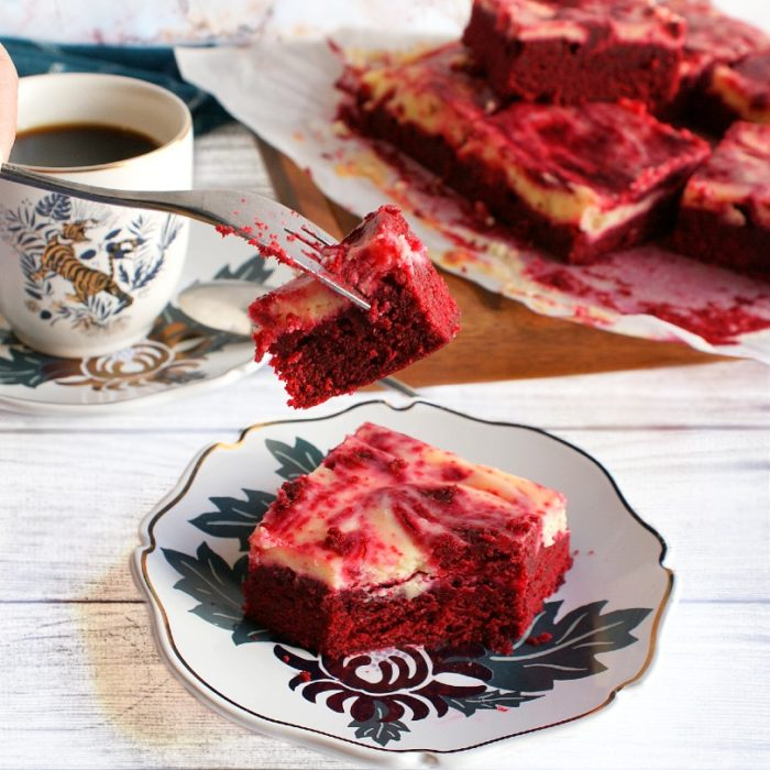 red velvet cheesecake swirl brownies  forked