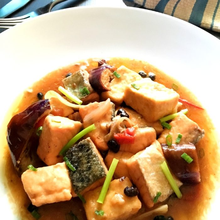 close up of salmon and tofu with tausi