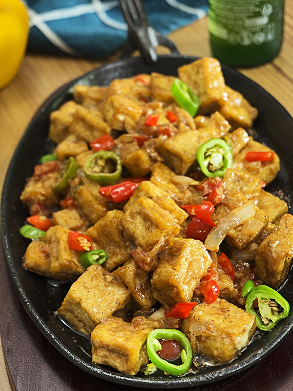 sizzling tokwa with chilies on top of table