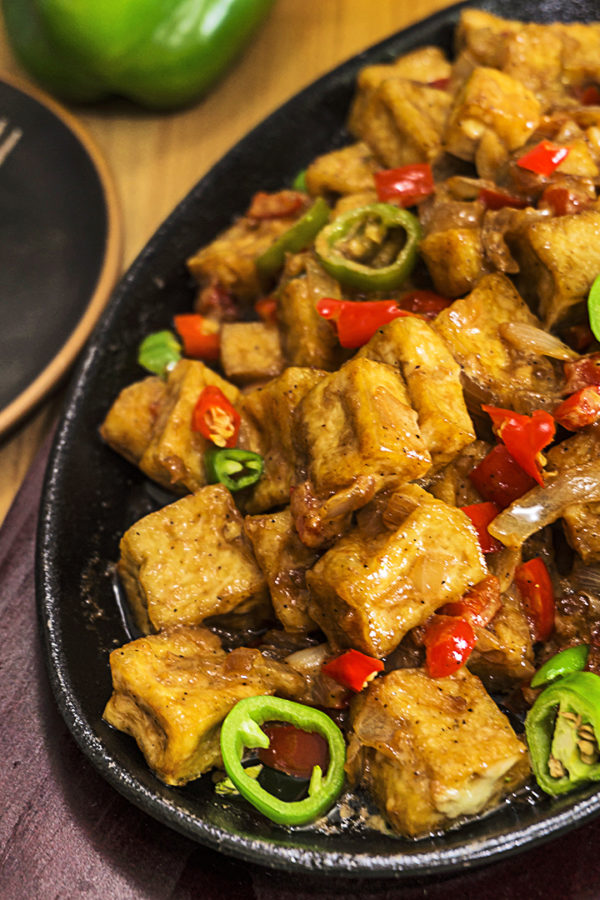 sizzling plate with tofu and chillies