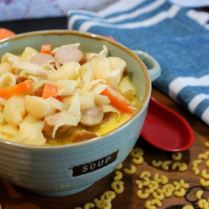 chicken sopas with carrots and hotdogs