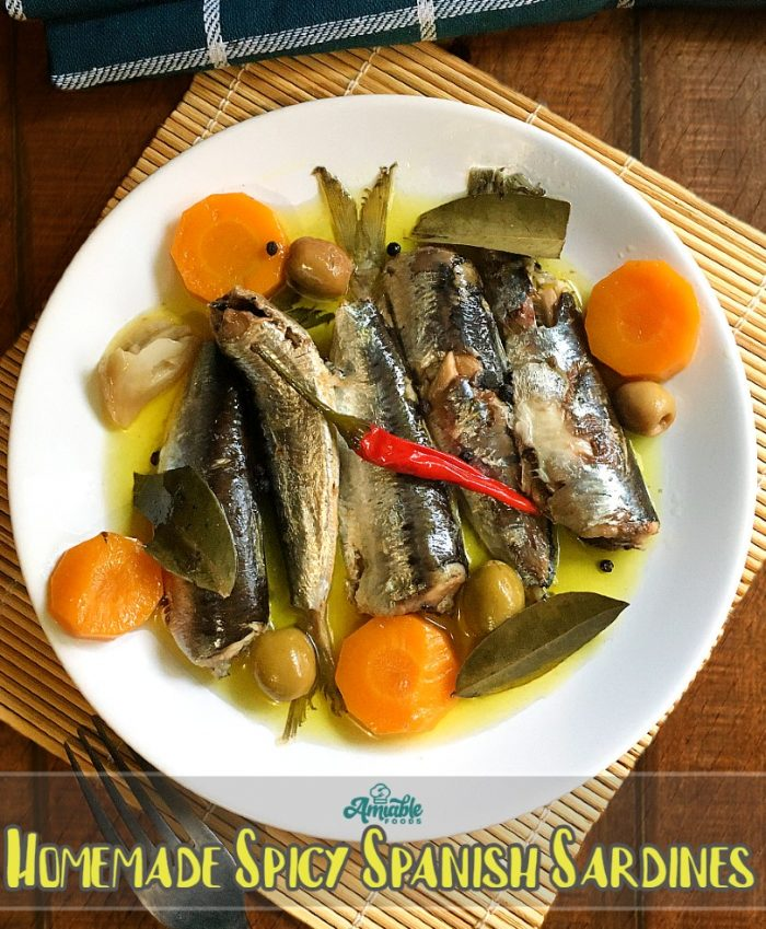 homemade spanish sardines on plate on table
