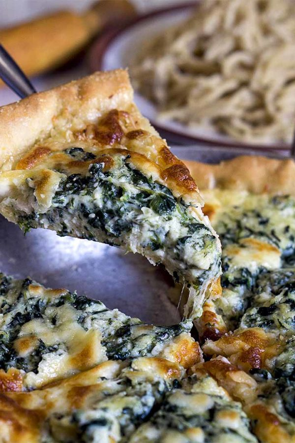 pie with spinach on hand