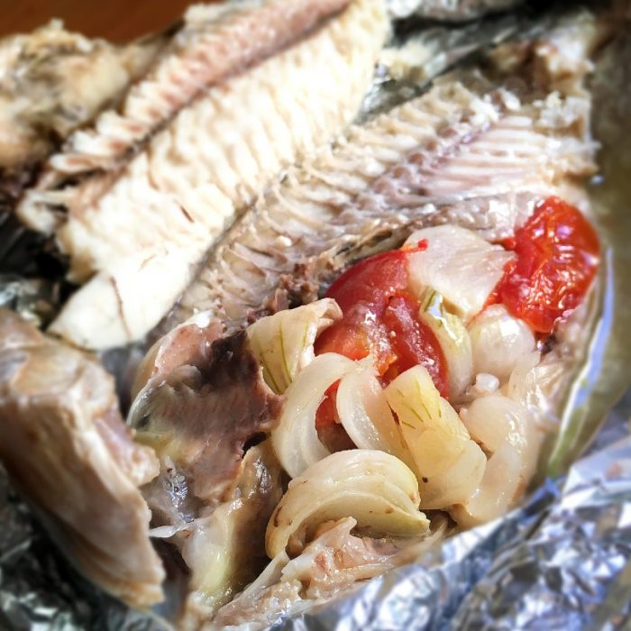 steamed fish with onion tomato stuffing