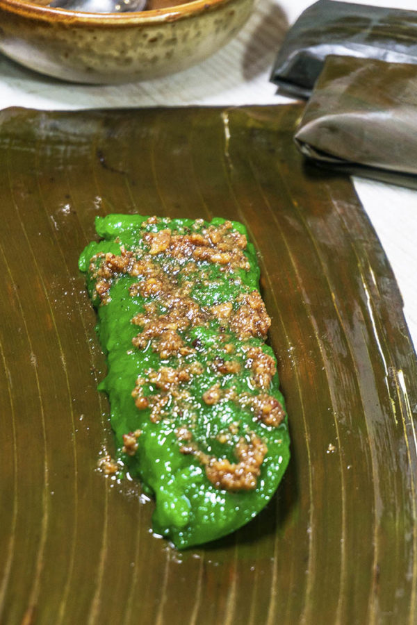 rice cake in banana leaf on top of table