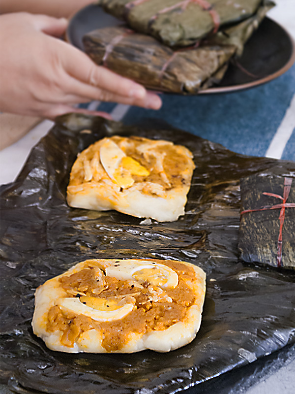 tamales on top of banana leaves