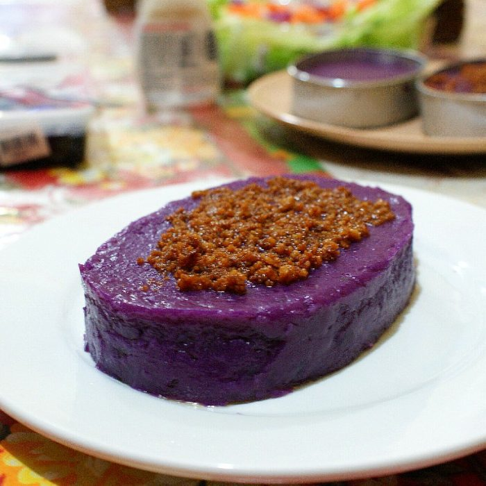 ube halaya on a plate with coconut curd
