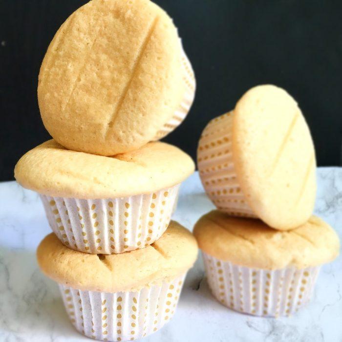 vanilla cupcakes on table